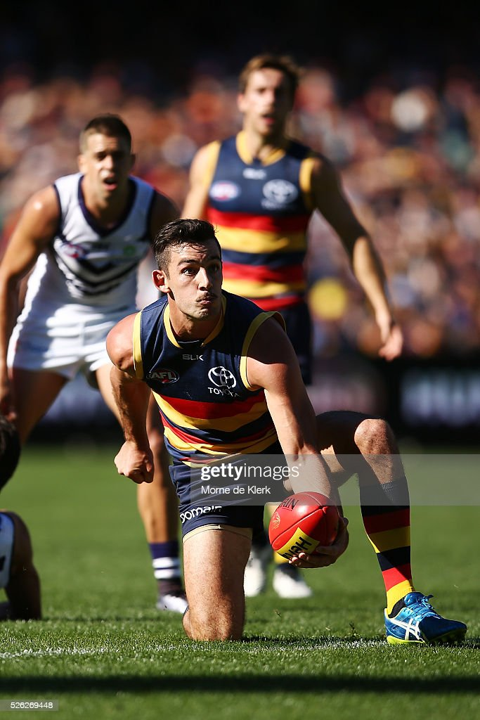 Taylor Walker of the Crows passes the ball during the round six AFL match between the Adelaide Crows and the Fremantle Dockers at Adelaide Oval on April 30, 2016 in Adelaide, Australia.