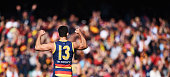 Taylor Walker of the Crows reacts after the final siren during the round 22 AFL match between the Adelaide Crows and the West Coast Eagles at...