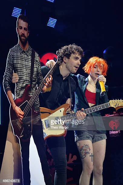Taylor York and Hayley Williams of Paramore perform onstage during Z100's Jingle Ball 2013 presented by Aeropostale at Madison Square Garden on...