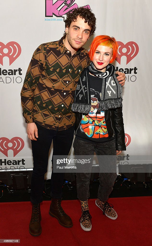 Taylor York and <a gi-track='captionPersonalityLinkClicked' href=/galleries/search?phrase=Hayley+Williams&family=editorial&specificpeople=4383581 ng-click='$event.stopPropagation()'>Hayley Williams</a> of Paramore pose backstage at KISS 108's Jingle Ball 2013 at TD Garden on December 14, 2013 in Boston, MA.