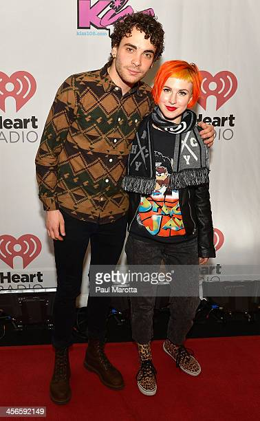 Taylor York and Hayley Williams of Paramore pose backstage at KISS 108's Jingle Ball 2013 at TD Garden on December 14 2013 in Boston MA