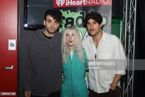 Taylor York Hayley Williams and Zac Farro of Paramore pose at Radio 1045 Performance Theater October 9 2017 in Bala Cynwyd Pennsylvania