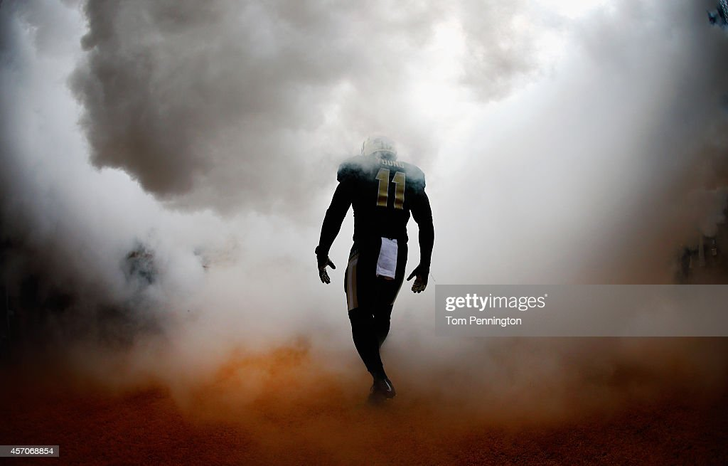 Taylor Young of the Baylor Bears walks on the field before taking on the TCU Horned Frogs at McLane Stadium on October 11 2014 in Waco Texas