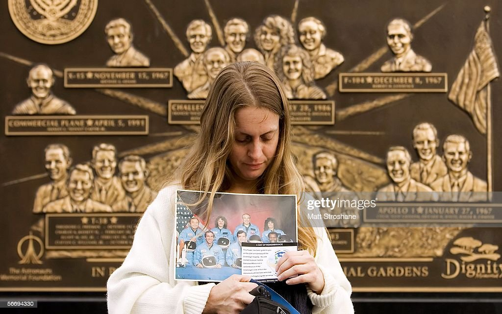 Tayna Southward of Cocoa Florida holds a photo of the Challenger astronauts before a memorial service on the 20th anniversary of the Space Shuttle...