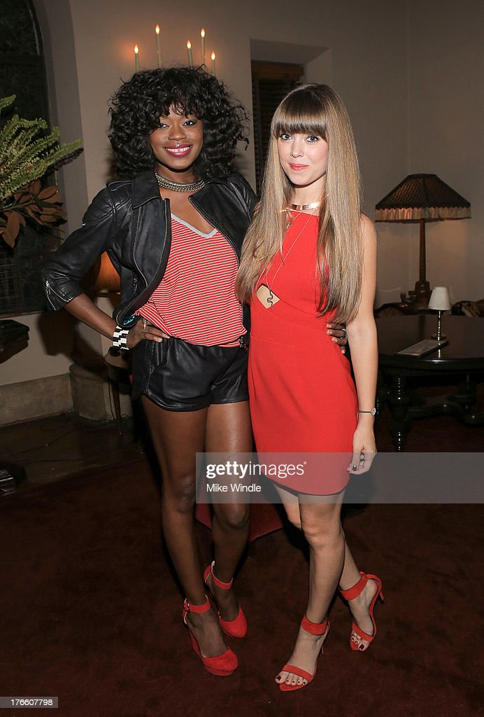 Tayo Otiti and Jenny Bernheim attend the SUPERDRY intimate dinner in celebration of the brand's Autumn/Winter 2013 Collection at Chateau Marmont on August 15, 2013 in Los Angeles, California.