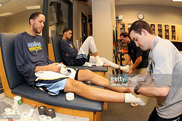 Tayshaun Prince and Austin Daye of the Memphis Grizzlies get taped up in the locker room before playing the Los Angeles Clippers in Game Six of the...