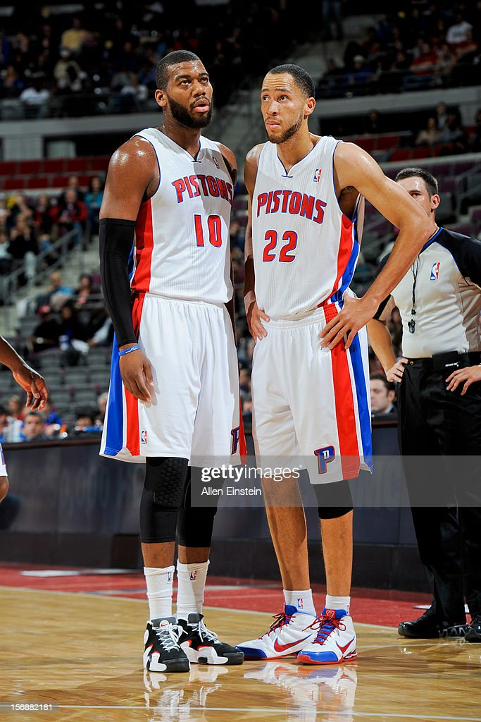Tayshaun Prince #22 and Greg Monroe #10 of the Detroit Pistons speak before resuming action against the Toronto Raptors on November 23, 2012 at The Palace of Auburn Hills in Auburn Hills, Michigan.