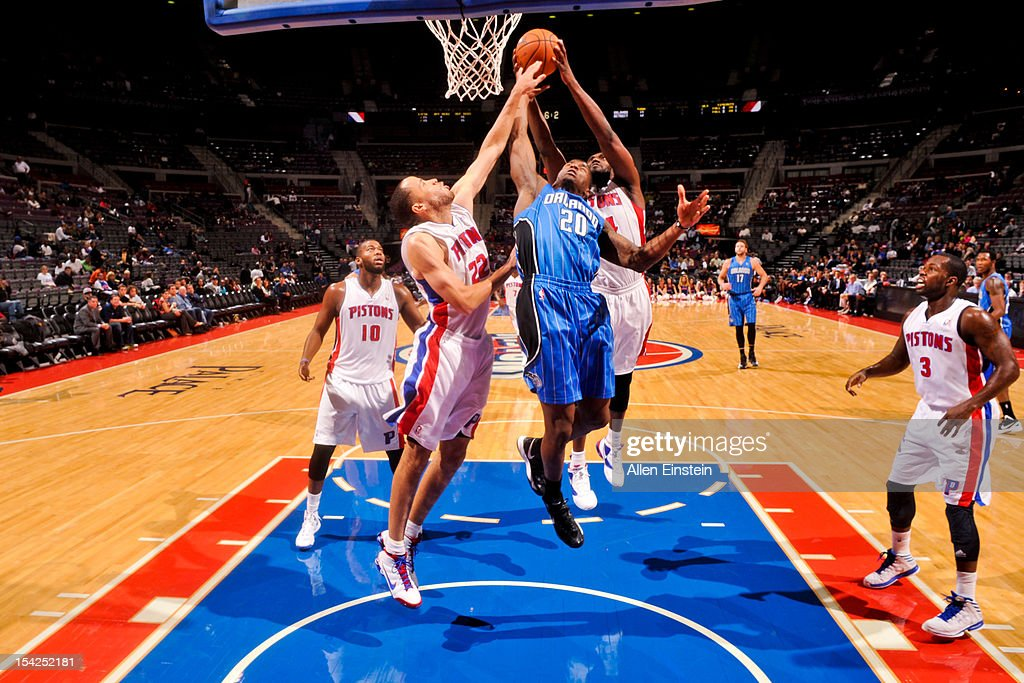 <a gi-track='captionPersonalityLinkClicked' href=/galleries/search?phrase=Tayshaun+Prince&family=editorial&specificpeople=201553 ng-click='$event.stopPropagation()'>Tayshaun Prince</a> #22 and <a gi-track='captionPersonalityLinkClicked' href=/galleries/search?phrase=Jason+Maxiell&family=editorial&specificpeople=651723 ng-click='$event.stopPropagation()'>Jason Maxiell</a> #54 of the Detroit Pistons go for a rebound against DeQuan Jones #20 of the Orlando Magic during a pre-season game on October 16, 2012 at The Palace of Auburn Hills in Auburn Hills, Michigan.