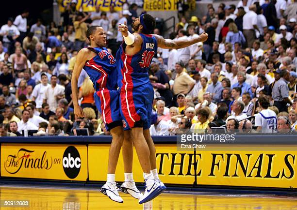 Tayshaun Prince and Rasheed Wallace of the Detroit Pistons celebrate in the final moments of their win over the Indiana Pacers in Game five of the...