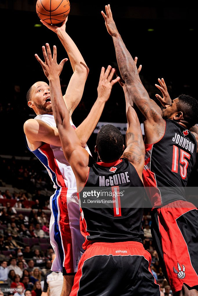 <a gi-track='captionPersonalityLinkClicked' href=/galleries/search?phrase=Tayshaun+Prince&family=editorial&specificpeople=201553 ng-click='$event.stopPropagation()'>Tayshaun Prince</a> #22 of the Detroit Pistons attempts a shot against <a gi-track='captionPersonalityLinkClicked' href=/galleries/search?phrase=Amir+Johnson&family=editorial&specificpeople=556786 ng-click='$event.stopPropagation()'>Amir Johnson</a> #15 and <a gi-track='captionPersonalityLinkClicked' href=/galleries/search?phrase=Dominic+McGuire&family=editorial&specificpeople=2537986 ng-click='$event.stopPropagation()'>Dominic McGuire</a> #1 of the Toronto Raptors on November 23, 2012 at The Palace of Auburn Hills in Auburn Hills, Michigan.