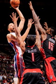 Tayshaun Prince of the Detroit Pistons attempts a shot against Amir Johnson and Dominic McGuire of the Toronto Raptors on November 23 2012 at The...