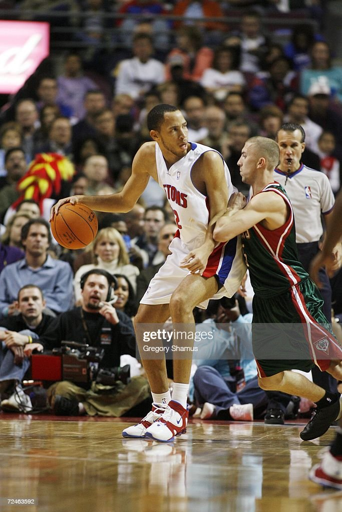 Tayshaun Prince #22 of the Detroit Pistons dribbles against Steve Blake #5 of the Milwaukee Bucks on November 1, 2006 at the Palace of Auburn Hills in Auburn Hills, Michigan. Milwaukee won the game 105-97.