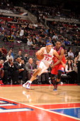 Tayshaun Prince of the Detroit Pistons drives against Craig Brackins of the Philadelphia 76ers during the game between the Detroit Pistons and the...