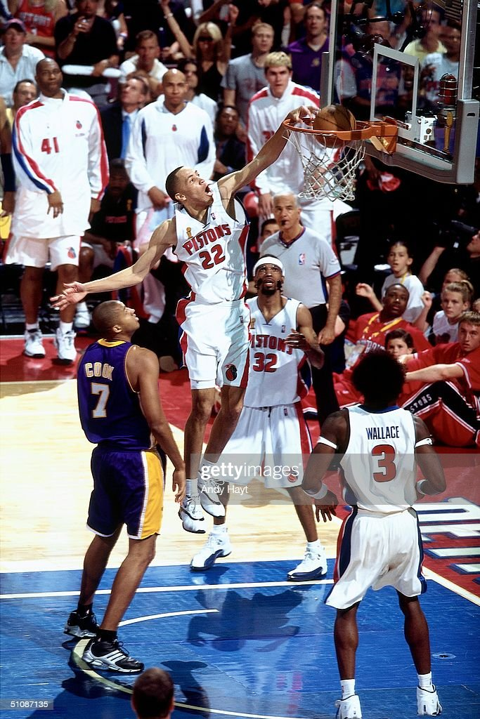 Tayshaun Prince #22 of the Detroit Pistons dunks over Brian Cook #7 of the Los Angeles Lakers during Game Five of the 2004 NBA Finals on June 15, 2004 at The Palace of Auburn Hills in Auburn Hills, Michigan.