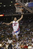 Tayshaun Prince of the Detroit Pistons dunks the ball during Game One of the Eastern Conference Quarterfinals of the 2004 NBA Playoffs against the...