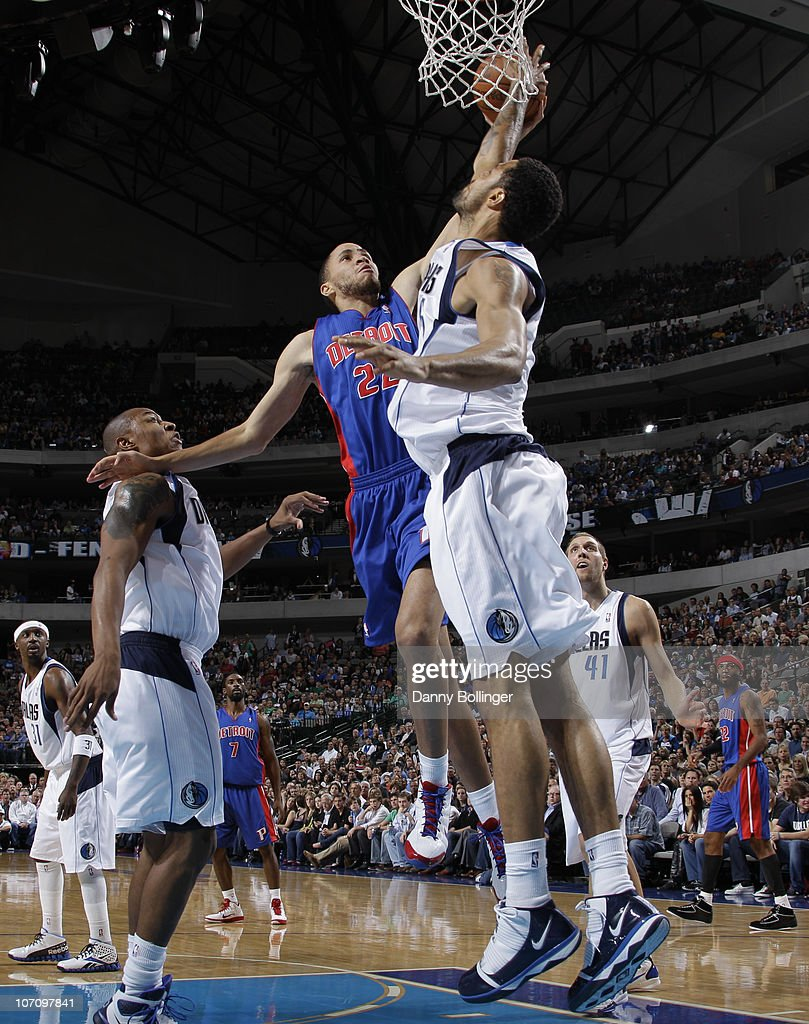 Tayshaun Prince #22 of the Detroit Pistons flies in for the dunk against Tyson Chandler #6 of the Dallas Mavericks during a game on November 23, 2010 at the American Airlines Center in Dallas, Texas.