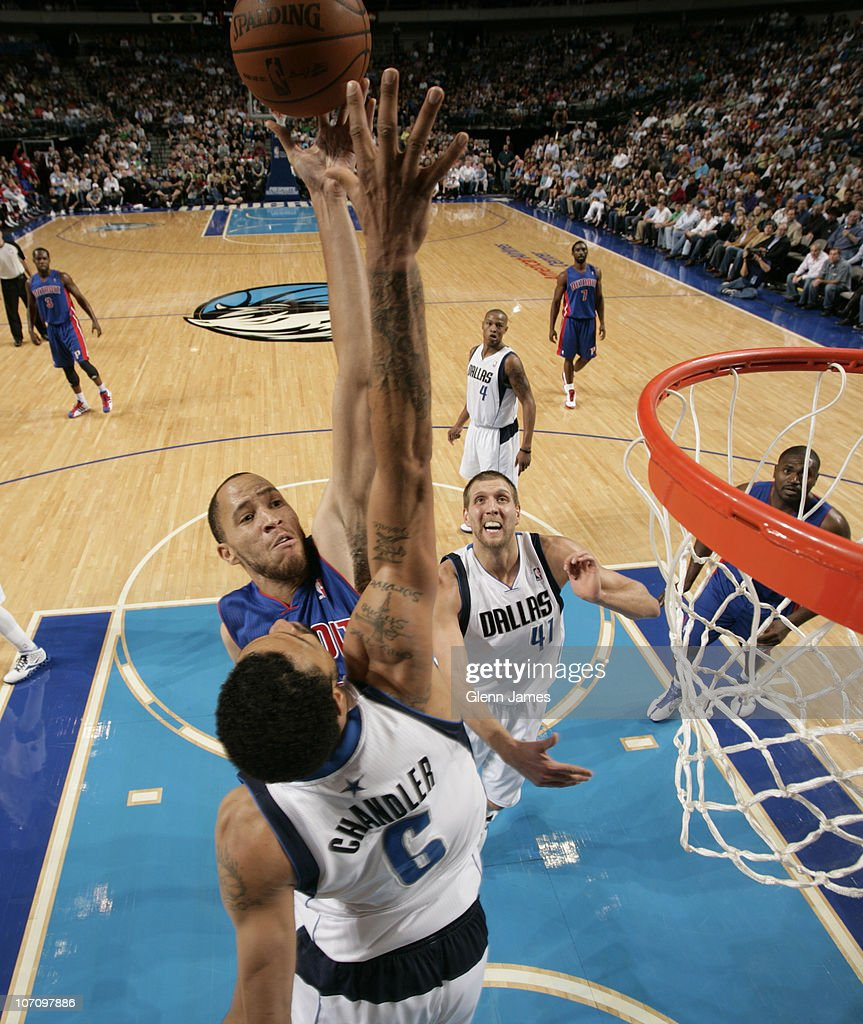 <a gi-track='captionPersonalityLinkClicked' href=/galleries/search?phrase=Tayshaun+Prince&family=editorial&specificpeople=201553 ng-click='$event.stopPropagation()'>Tayshaun Prince</a> #22 of the Detroit Pistons goes in for the layup against <a gi-track='captionPersonalityLinkClicked' href=/galleries/search?phrase=Tyson+Chandler&family=editorial&specificpeople=202061 ng-click='$event.stopPropagation()'>Tyson Chandler</a> #6 of the Dallas Mavericks during a game on November 23, 2010 at the American Airlines Center in Dallas, Texas.