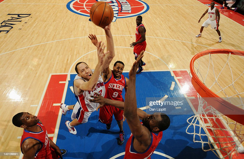 Tayshaun Prince of the Detroit Pistons goes to the basket against Andre Iguodala of the Philadelphia 76ers during the game on February 28 2012 at The...