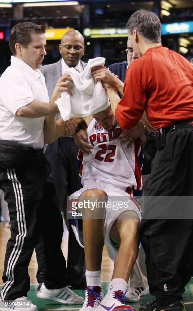 Tayshaun Prince of the Detroit Pistons is helped off the court in the first quarter against the Boston Celtics on March 15 2010 at the TD Garden in...