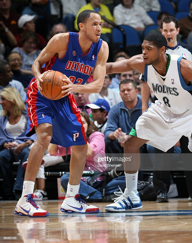 Tayshaun Prince of the Detroit Pistons looks to move the ball against Ryan Gomes of the Minnesota Timberwolves during the game on April 14 2010 at...