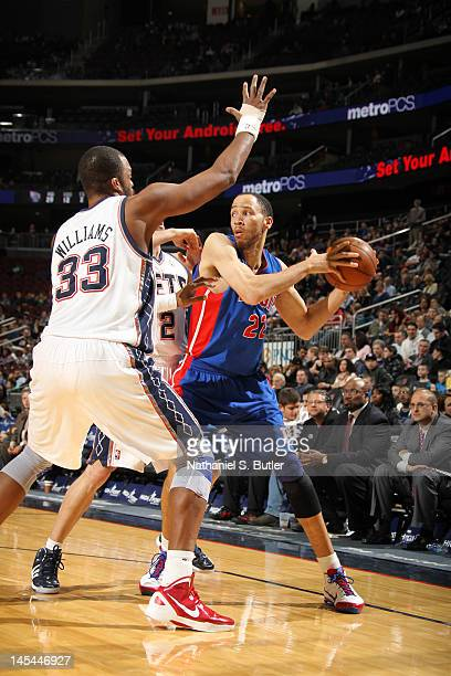 Tayshaun Prince of the Detroit Pistons looks to pass against Shelden Williams of the New Jersey Nets during the game on February 1 2012 at the...
