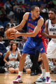 Tayshaun Prince of the Detroit Pistons looks to pass the ball under pressure from Ryan Gomes of the Minnesota Timberwolves during the game on April...