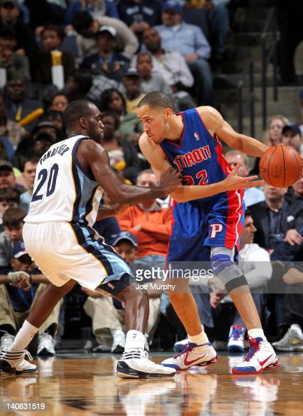 Tayshaun Prince of the Detroit Pistons looks to score against Quincy Pondexter of the Memphis Grizzlies on March 3 2012 at FedExForum in Memphis...