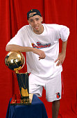 Tayshaun Prince of the Detroit Pistons poses for a portrait with the Larry O'Brien NBA Championship Trophy after winning the 2004 NBA Championship...