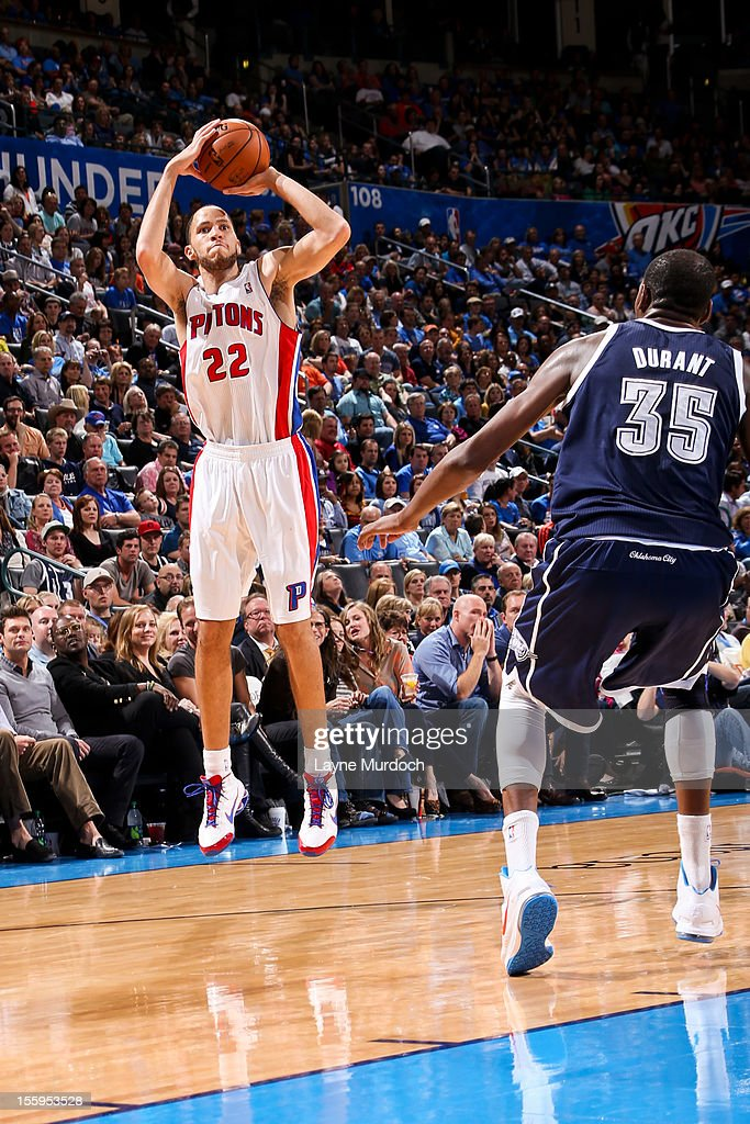 <a gi-track='captionPersonalityLinkClicked' href=/galleries/search?phrase=Tayshaun+Prince&family=editorial&specificpeople=201553 ng-click='$event.stopPropagation()'>Tayshaun Prince</a> #22 of the Detroit Pistons shoots a three-pointer against <a gi-track='captionPersonalityLinkClicked' href=/galleries/search?phrase=Kevin+Durant&family=editorial&specificpeople=3847329 ng-click='$event.stopPropagation()'>Kevin Durant</a> #35 of the Oklahoma City Thunder on November 9, 2012 at the Chesapeake Energy Arena in Oklahoma City, Oklahoma.