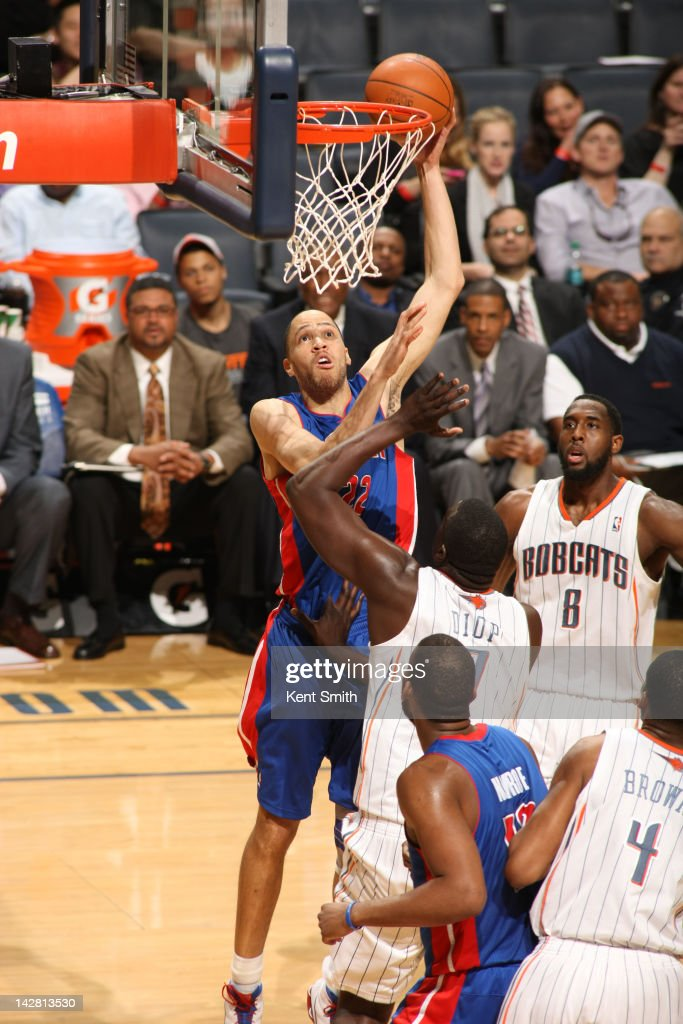 <a gi-track='captionPersonalityLinkClicked' href=/galleries/search?phrase=Tayshaun+Prince&family=editorial&specificpeople=201553 ng-click='$event.stopPropagation()'>Tayshaun Prince</a> #22 of the Detroit Pistons shoots against <a gi-track='captionPersonalityLinkClicked' href=/galleries/search?phrase=DeSagana+Diop&family=editorial&specificpeople=213233 ng-click='$event.stopPropagation()'>DeSagana Diop</a> #7 of the Charlotte Bobcats at the Time Warner Cable Arena on April 12, 2012 in Charlotte, North Carolina.