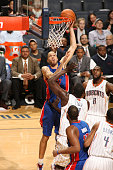 Tayshaun Prince of the Detroit Pistons shoots against DeSagana Diop of the Charlotte Bobcats at the Time Warner Cable Arena on April 12 2012 in...