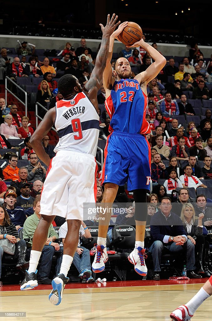 Tayshaun Prince #22 of the Detroit Pistons shoots over Martell Webster #9 of the Washington Wizards at the Verizon Center on December 22, 2012 in Washington, DC.