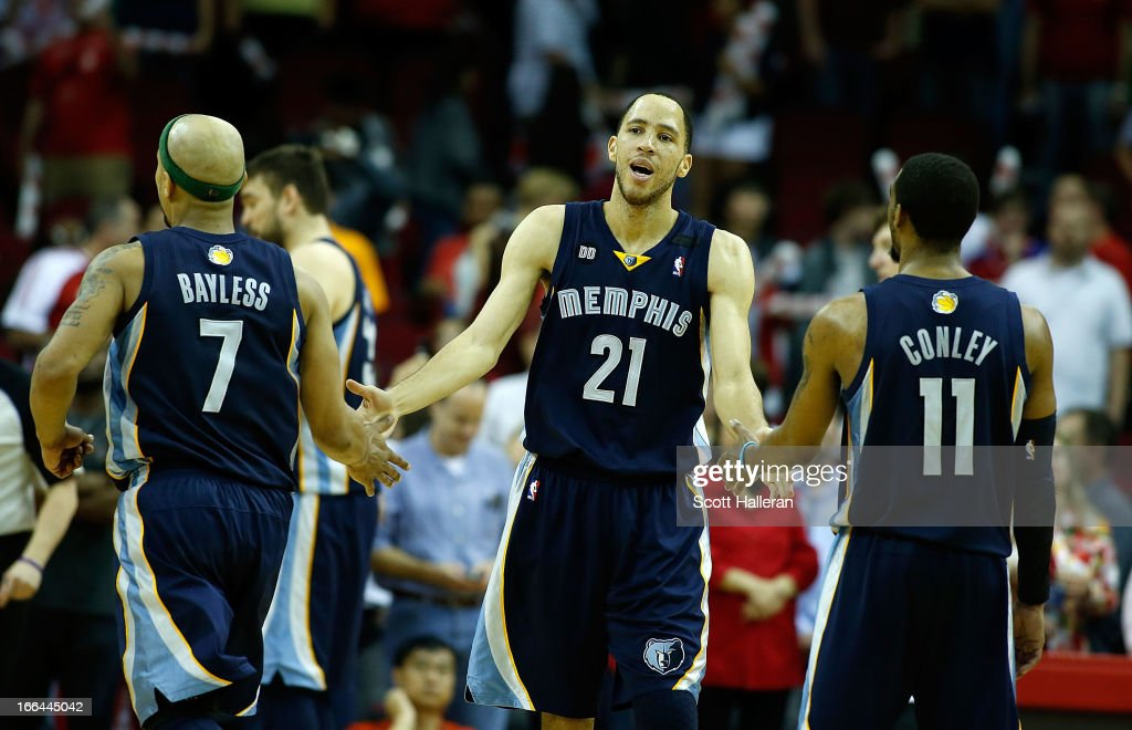 <a gi-track='captionPersonalityLinkClicked' href=/galleries/search?phrase=Tayshaun+Prince&family=editorial&specificpeople=201553 ng-click='$event.stopPropagation()'>Tayshaun Prince</a> #21 of the Memphis Grizzlies celebrates a free throw with teammates <a gi-track='captionPersonalityLinkClicked' href=/galleries/search?phrase=Jerryd+Bayless&family=editorial&specificpeople=4216027 ng-click='$event.stopPropagation()'>Jerryd Bayless</a> #7 and Mike Conley #11 in fourth quarter during the game against the Houston Rockets at the Toyota Center on April 12, 2013 in Houston, Texas.