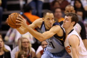 Tayshaun Prince of the Memphis Grizzlies looks to move the bal under pressure from Goran Dragic of the Phoenix Suns during the second half of the NBA...