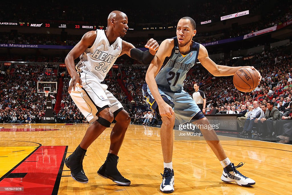 Tayshaun Prince #21 of the Memphis Grizzlies posts up against Ray Allen #34 of the Miami Heat on March 1, 2013 at American Airlines Arena in Miami, Florida.