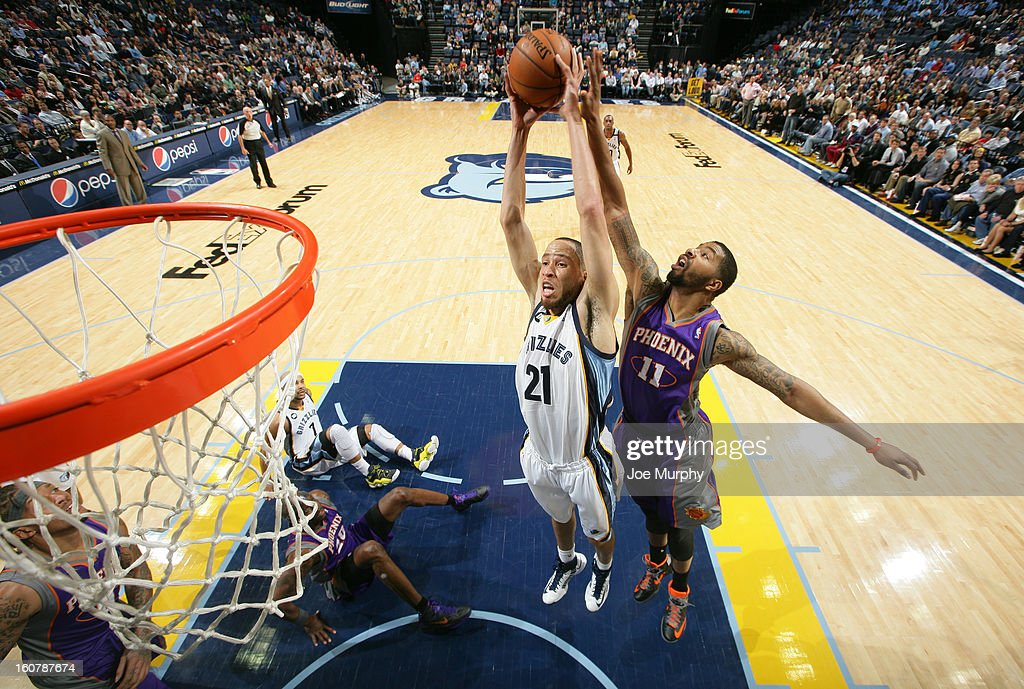 Tayshaun Prince #21 of the Memphis Grizzlies rebounds against Markieff Morris #11 of the Phoenix Suns on February 5, 2013 at FedExForum in Memphis, Tennessee.