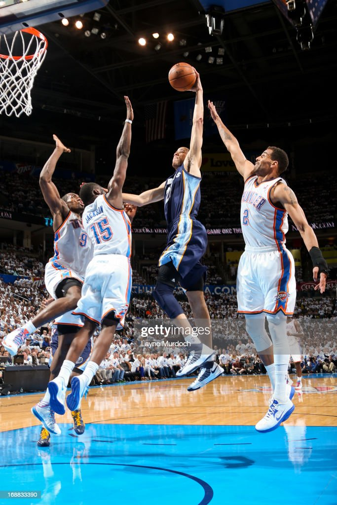 Tayshaun Prince of the Memphis Grizzlies rises for a dunk against Serge Ibaka Reggie Jackson and Thabo Sefolosha of the Oklahoma City Thunder in Game...