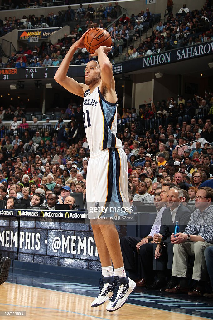 <a gi-track='captionPersonalityLinkClicked' href=/galleries/search?phrase=Tayshaun+Prince&family=editorial&specificpeople=201553 ng-click='$event.stopPropagation()'>Tayshaun Prince</a> #21 of the Memphis Grizzlies shoots a three pointer against the Oklahoma City Thunder on March 20, 2013 at FedExForum in Memphis, Tennessee.