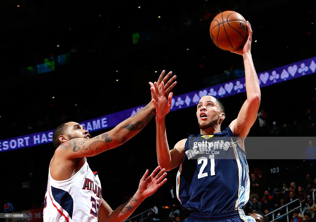 Tayshaun Prince of the Memphis Grizzlies shoots against Mike Scott of the Atlanta Hawks at Philips Arena on January 7 2015 in Atlanta Georgia NOTE TO...
