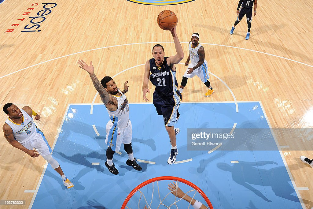 <a gi-track='captionPersonalityLinkClicked' href=/galleries/search?phrase=Tayshaun+Prince&family=editorial&specificpeople=201553 ng-click='$event.stopPropagation()'>Tayshaun Prince</a> #21 of the Memphis Grizzlies shoots in the lane against <a gi-track='captionPersonalityLinkClicked' href=/galleries/search?phrase=Wilson+Chandler&family=editorial&specificpeople=809324 ng-click='$event.stopPropagation()'>Wilson Chandler</a> #21 of the Denver Nuggets on March 15, 2013 at the Pepsi Center in Denver, Colorado.