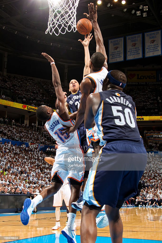 <a gi-track='captionPersonalityLinkClicked' href=/galleries/search?phrase=Tayshaun+Prince&family=editorial&specificpeople=201553 ng-click='$event.stopPropagation()'>Tayshaun Prince</a> #21 of the Memphis Grizzlies shoots in the lane against Reggie Jackson #15 and <a gi-track='captionPersonalityLinkClicked' href=/galleries/search?phrase=Serge+Ibaka&family=editorial&specificpeople=5133378 ng-click='$event.stopPropagation()'>Serge Ibaka</a> #9 of the Oklahoma City Thunder in Game Five of the Western Conference Semifinals during the 2013 NBA Playoffs on May 15, 2013 at the Chesapeake Energy Arena in Oklahoma City, Oklahoma.