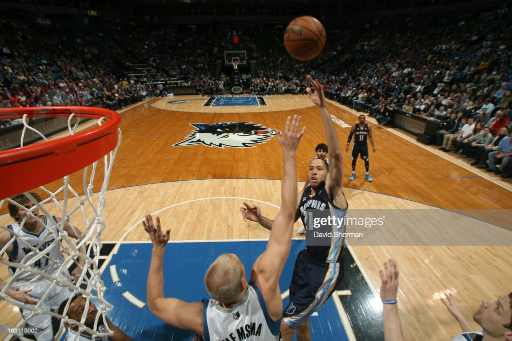 Tayshaun Prince #21 of the Memphis Grizzlies shoots the ball against Greg Stiemsma #34 of the Minnesota Timberwolves during the game between the Memphis Grizzlies and the Minnesota Timberwolves on March 30, 2013 at Target Center in Minneapolis, Minnesota.