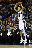 Tayshaun Prince of the Memphis Grizzlies takes a shot during a game against the San Antonio Spurs at the FedExForum on December 30 2014 in Memphis...