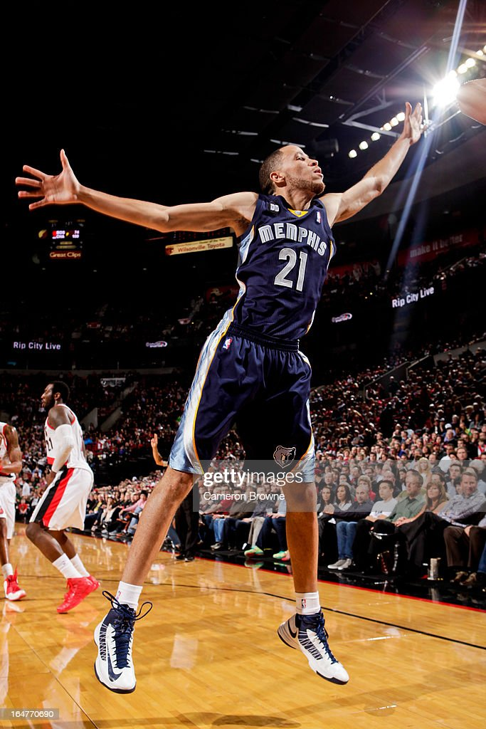 <a gi-track='captionPersonalityLinkClicked' href=/galleries/search?phrase=Tayshaun+Prince&family=editorial&specificpeople=201553 ng-click='$event.stopPropagation()'>Tayshaun Prince</a> #21 of the Memphis Grizzlies tries to block a shot attempt by the Portland Trail Blazers on March 12, 2013 at the Rose Garden Arena in Portland, Oregon.