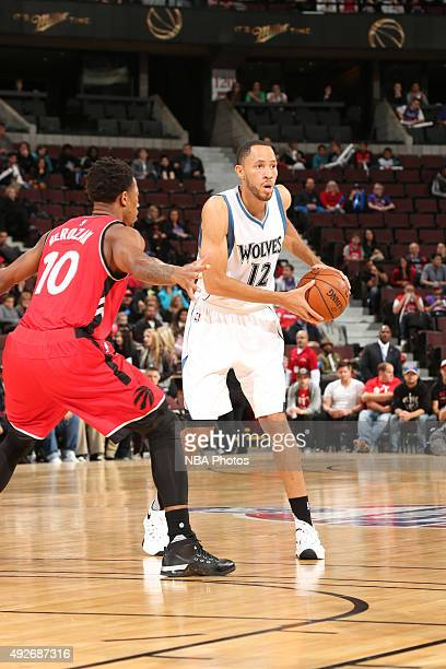 Tayshaun Prince of the Minnesota Timberwolves handles the ball against DeMar DeRozan of the Toronto Raptors at Canadian Tire Centre on October 14...