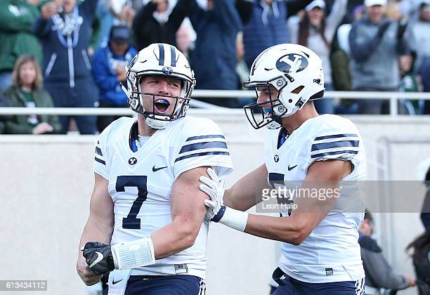 Taysom Hill of the Brigham Young Cougars celebrates a fourth quarter touchdown during the game against the Michigan State Spartans at Spartan Stadium...