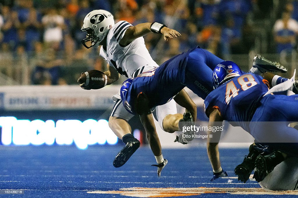Taysom Hill #4 of the BYU Cougars is brought down by Jeremy Ioane #10 of the Boise State Broncos at Bronco Stadium on September 20, 2012 in Boise, Idaho.