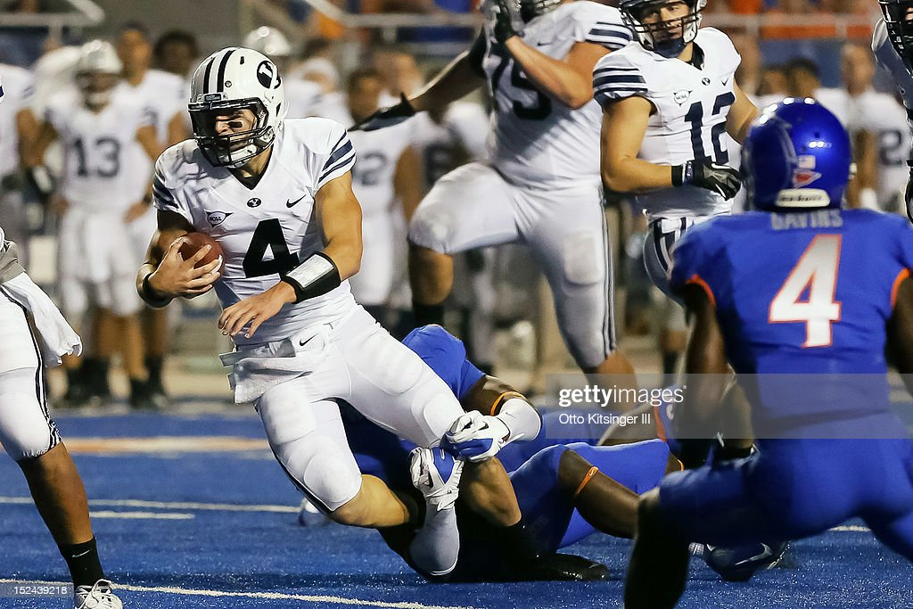 Taysom Hill #4 of the BYU Cougars is brought down by the Boise State Broncos at Bronco Stadium on September 20, 2012 in Boise, Idaho.