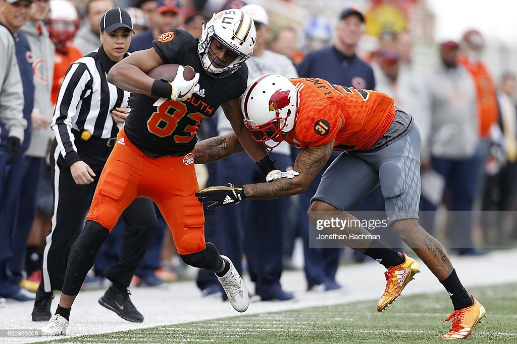 Taywan Taylor #82 of the South team is tackled by Brendan Langley #31 of the North team during the first half of the Reese's Senior Bowl at the Ladd-Peebles Stadium on January 28, 2017 in Mobile, Alabama.