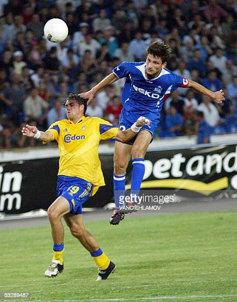 David Gigauri of Dinamo Tbilisi vies 26 July 2005 with Kim Daugaard of FC Brondby during the Champions League second qualifying round Tbilisi AFP...